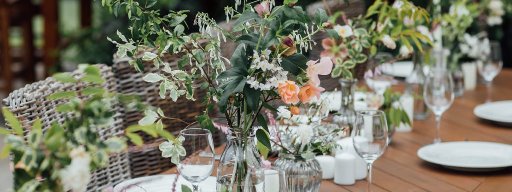 Vase of Flowers on Wooden Table. Set Up for a Wedding