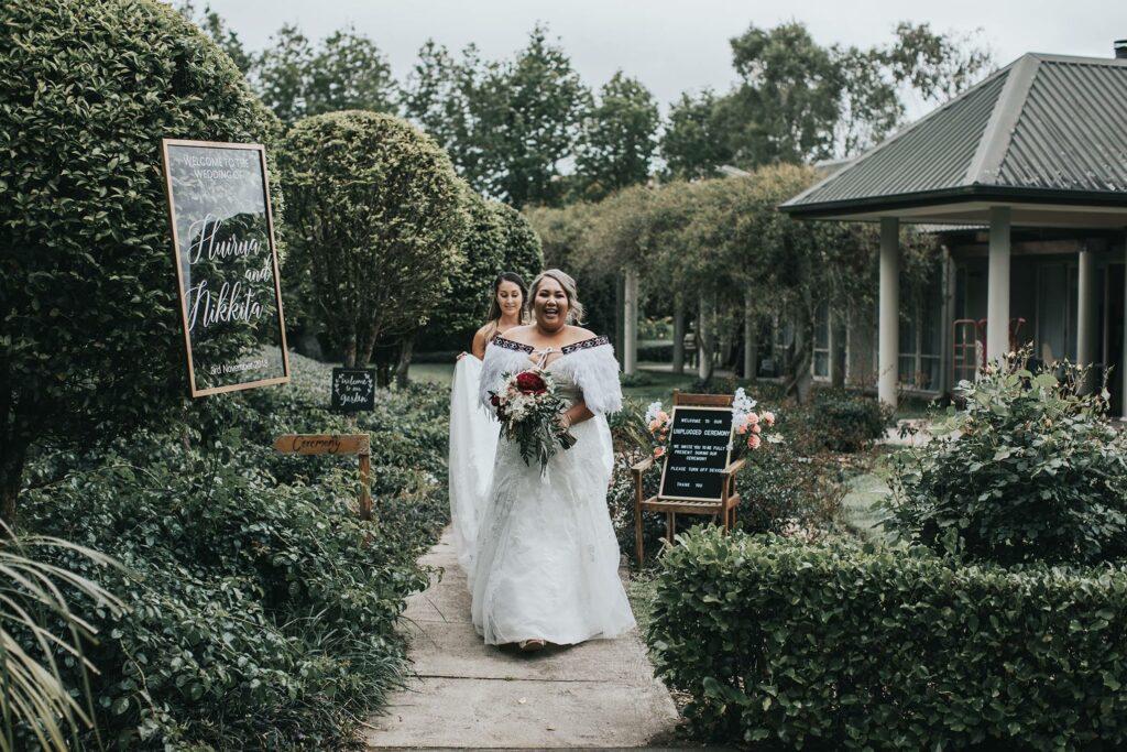 Bride Walking Up The Aisle of Stunning Garden Venue at Tabula Rasa